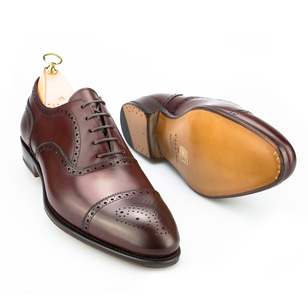 """This gives the oxford a clean look and a slim silhouette, making it perfect for suits. Meanwhile, brogues denote """"broguing,"""" a kind of ornamentation created by small perforations or holes. Any shoe with broguing is called a brogue, even if it's an oxford. Hence, brogues and oxfords are not mutually exclusive."""