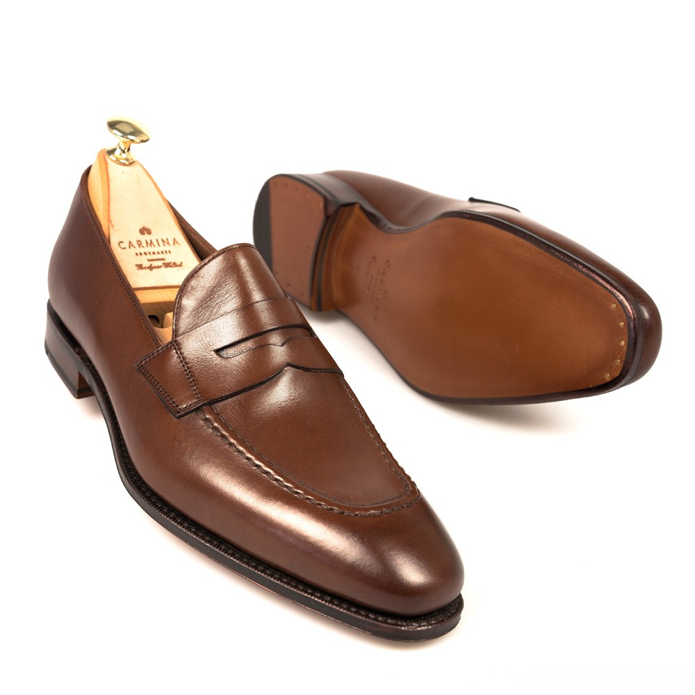ec0cd88f725 PENNY LOAFERS IN BROWN VEGANO. 395.00€